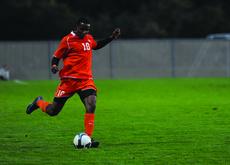 Danny Mwanga goes for a kick on the field.