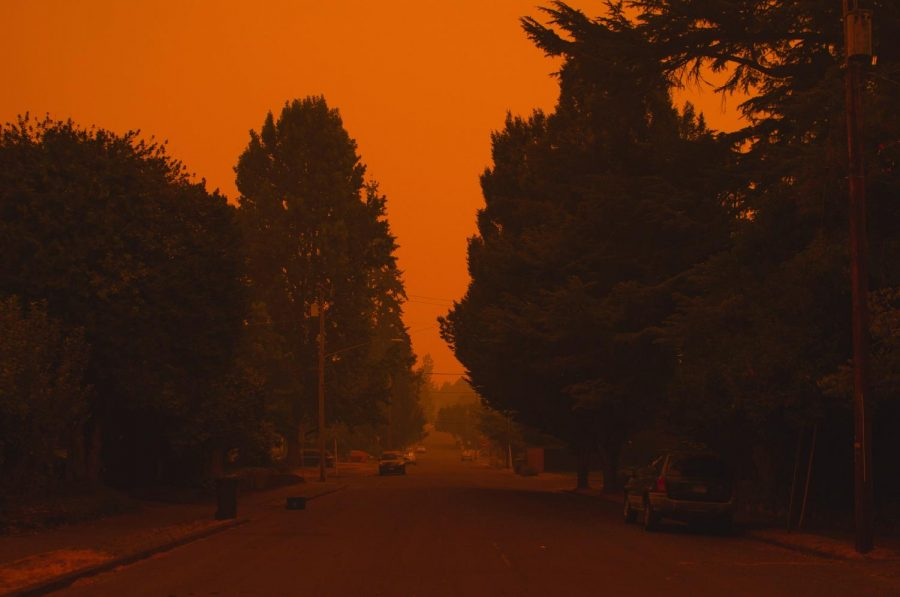 The+view+down+30th+Street+in+Corvallis%2C+Ore.+on+Sept.+8%2C+2020+was+hazy+and+red+as+fires+throughout+Oregon+continued+to+burn.+The+Red+coloring+of+the+sky+is+due+to+phenomenon+called+Mie+Scattering+when+dust+and+soot+in+the+air+can+scatter+light+with+longer+wave+lengths.