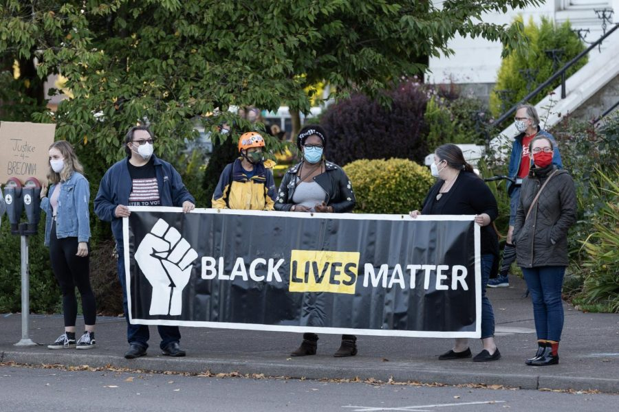 Corvallis+City+Councilman+Charles+Maughan+%28left%29%2C+holding+Black+Lives+Matter+banner+with+fellow+members+of+the+community+during+Saturdays+Breonna+Taylor+Protest.%C2%A0