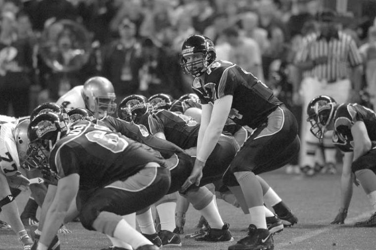 Derek+Anderson+looks+over+his+line+at+the+Notre+Dame+defense+before+taking+a+snap+during+the+Insight+Bowl.+Anderson+was+a+Pac-10+second+team+selection+in+2004+and+second+on+Oregon+States+career+passing+leaders+list.Photo+from+OMN+Archives