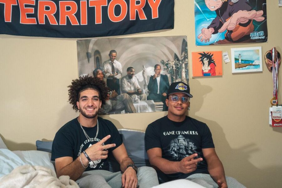 Roommates and OSU senior wrestlers Adam Rateb (left) and Mateo Olmos (right) pictured in Adam's bedroom behind his favorite poster of his idols. Adam and Mateo participated in the Black Lives Matter rally in Washington DC this past summer.