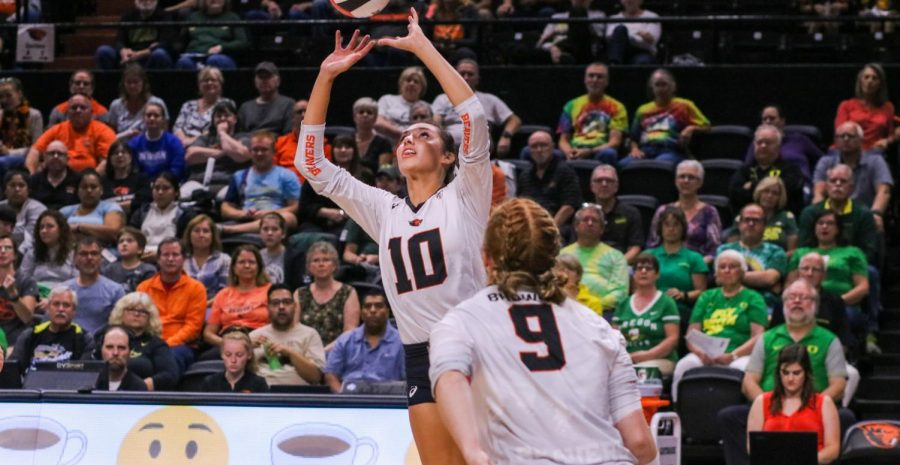 OSU Volleyball senior outside hitter Maddie Goings sets the ball.