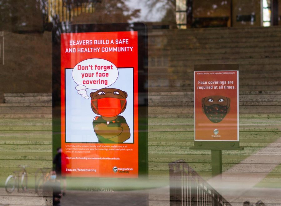 Signs requiring masks within OSU buildings are posted up around campus, including at the Memorial Union.