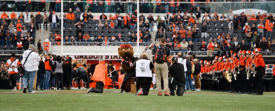In+this+file+photo+from+October+2019%2C+OSU+alumni+and+mascot+Benny+Beaver+line+up+to+welcome+the+Beavers+to+the+field+at+the+Homecoming+football+game.+While+the+Beavers+dont+currently+have+any+football+games+scheduled+for+the+early+morning%2C+the+PAC-12+Conference+has+begun+scheduling+a+handful+of+games+for+9+a.m.+for+the+first+time+since+the+conference+expanded+to+12+teams.