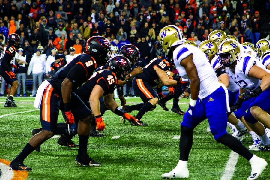In this file photo from 2019, The Washington Huskies' offense lines up against the Oregon State Beavers' defense in their Friday night matchup in Reser on Nov. 8. On Nov. 14, 2020, Oregon State will get the chance to even the score against the Huskies after their 19-7 loss in 2019.