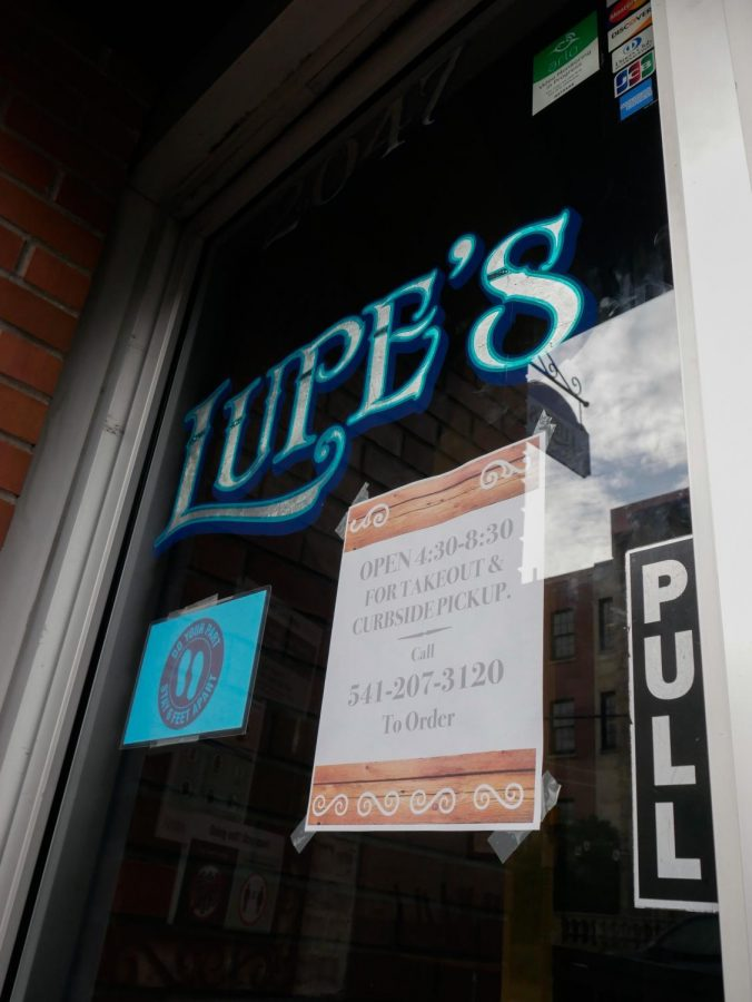 The front door of Lupe's, displaying their hours and availability during Oregon's two week freeze. Due to the two week freeze, many restaurants are staying open for shorter hours and only doing takeout orders.