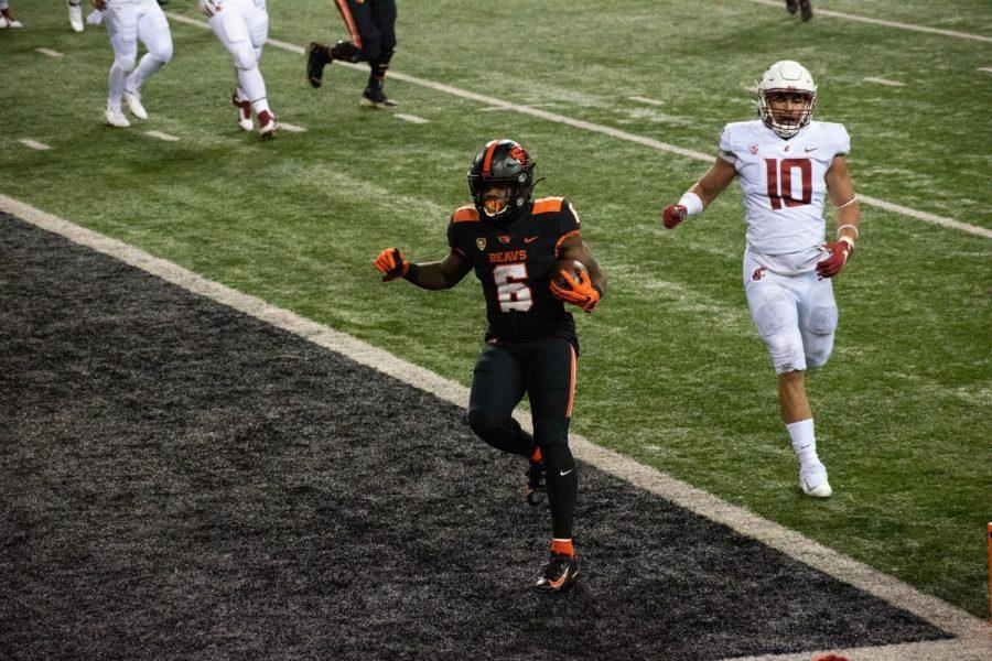 Jermar Jefferson scores a touchdown against Washington State on November 7th in Reser Stadium.