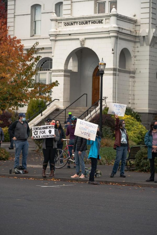 Members of the Corvallis community gather for the Count Every Vote rally on Nov. 4 at the Benton County Courthouse. As the election continues, protestors express their concerns.