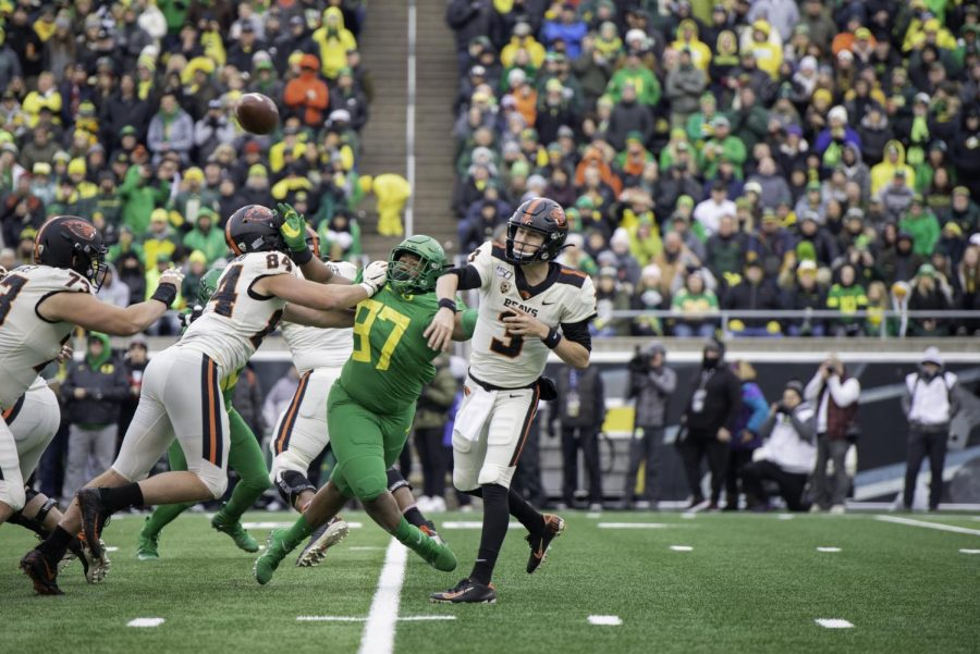 In+this+file+photo+from+2019%2C+OSU+redshirt+sophomore+quarterback+Tristan+Gebbia+%28%233%29+throws+a+pass+while+under+pressure+from+UO+freshman+defensive+tackle+Brandon+Dorlus+%28%2397%29+in+Autzen+Stadium.%C2%A0This+season%2C+Gebbia+was+able+to+get+his+revenge+in+a+41-38+win+over+the+Oregon+Ducks.