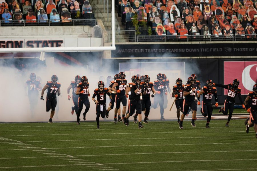 In+this+file+photo+from+Nov.+7%2C+2020%2C+The+Beaver+Football+team+storms+Reser+Stadium+through+a+cloud+of+smoke+on+November+7th+at+7%3A30pm+for+their+game+against+Washington+State.+The+Beavers+finished+the+2020+season+with+a+2-5+record%2C+and+now+look+ahead+to+2021s+campaign+during+the+offseason.