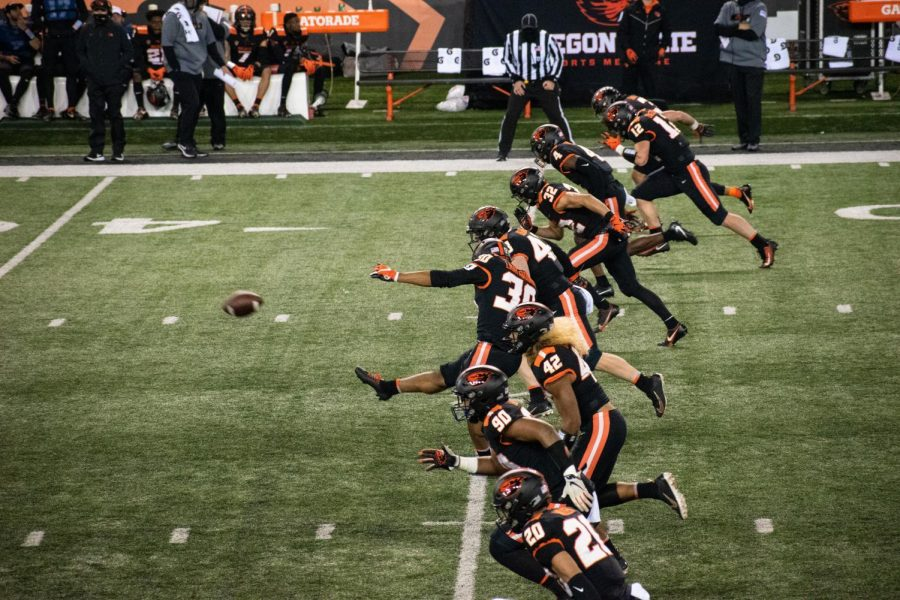 In this file photo from Nov. 7, 2020, Caleb Lightbourn kicks the football down Reser Stadium against Washington State. After falling short against Washington State the week prior, the Beavers were unable to grab the win against the Washington Huskies on Nov.14, losing 27-21 on the road.