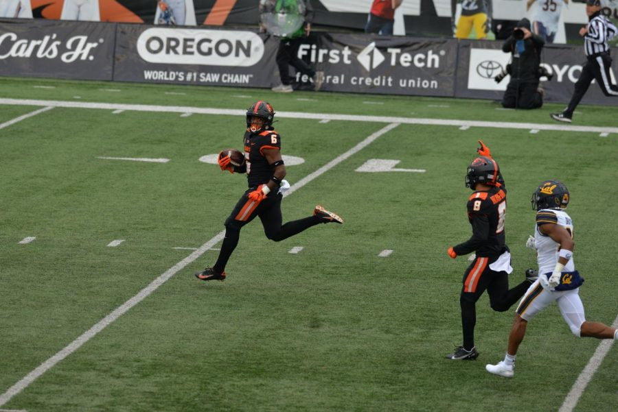 Oregon State University Running Back Jermar Jefferson looking back while breaking open a 75 yard touchdown for the opening play. Jefferson had 196 yards in Oregon State's victory over the University of California Golden Bears.