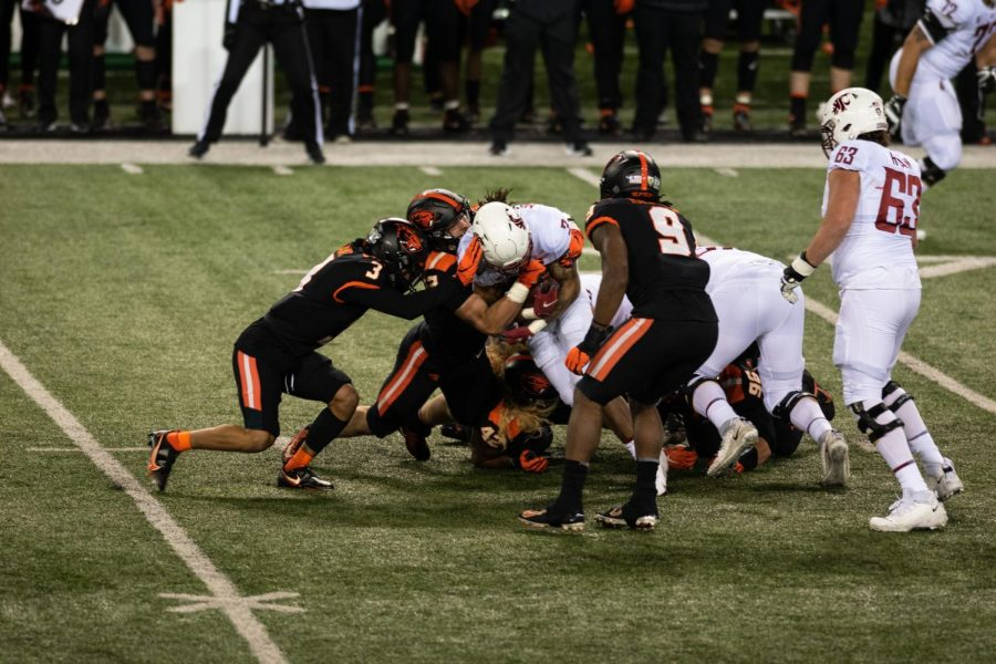 The Beaver Football team gives it their all while playing defense against Washington State on November 7th.