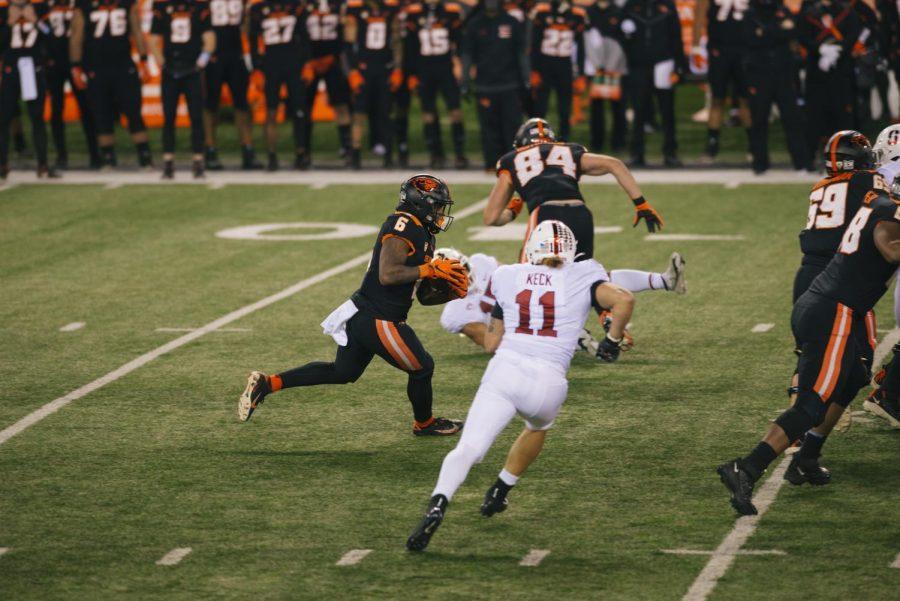 OSU Junior, Jermar Jefferson, tries to find a break in the Stanford defense.