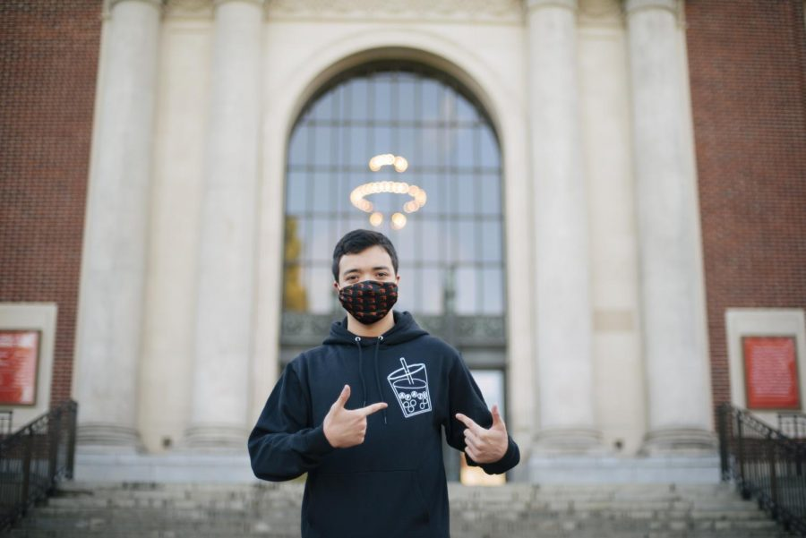 Josh Brenne, co-president of theAsian Pacific American Student Union, poses outside of the Memorial Union in his APASU hoodie and OSU mask.The APASU organization is a mean for people of similar cultural backgrounds or interests to come together socially and culturally.