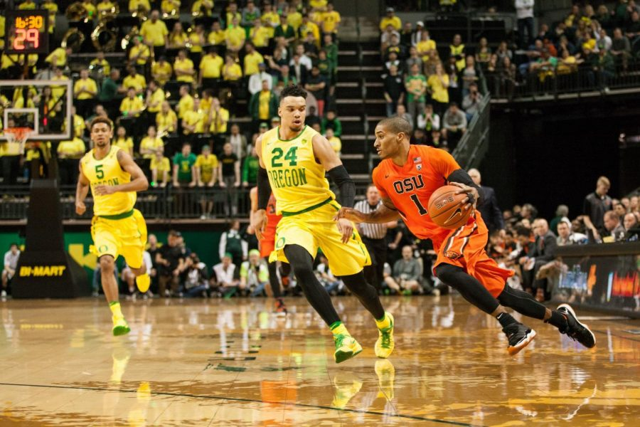 In+this+file+photo+from+2016%2C+senior+guard+Gary+Payton+II+looks+to+set+up+the+offense+against+sophomore+forward+Dillon+Brooks.%C2%A0
