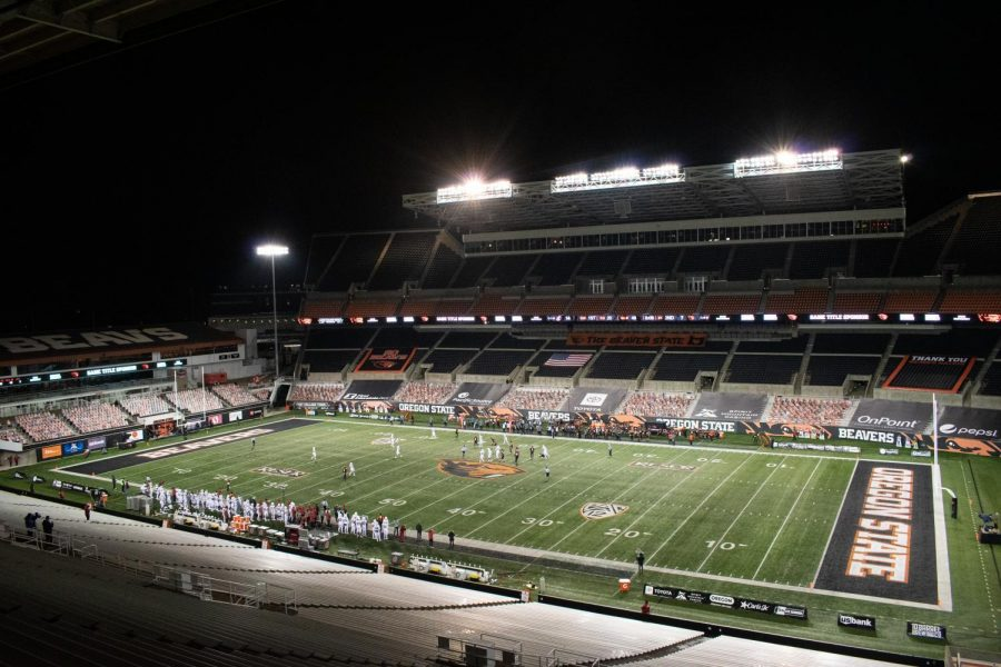 In+this+file+photo+from+Nov.+7%2C+2020%2C+Oregon+State+plays+against+Washington+State+while+an+empty+Reser+Stadium+looms+over+them.+During+the+2020+football+season%2C%C2%A0Oregon+State+students+were+unable+to+attend+the+games+typically+accessible+via+the+athletics+fee+due+to+COVID-19+regulations+on+attendance.%C2%A0
