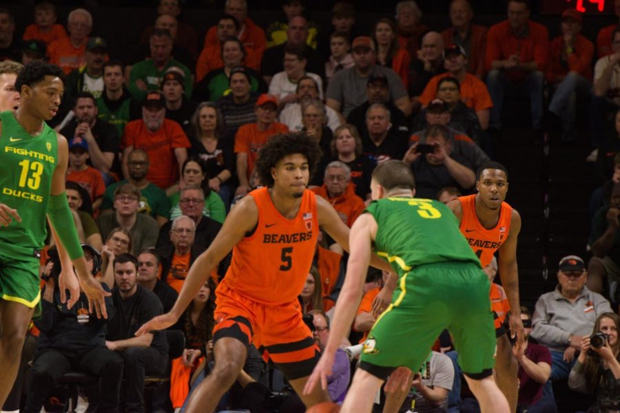 In this file photo from Feb. 27, 2020, OSU guard Ethan Thompson attempts to defend against UO senior guard Payton Pritchard in the Civil War matchup in Gill Coliseum on Feb. 8. Now a senior, Thompson has played in a fair share of rivalry games against the Oregon Ducks.