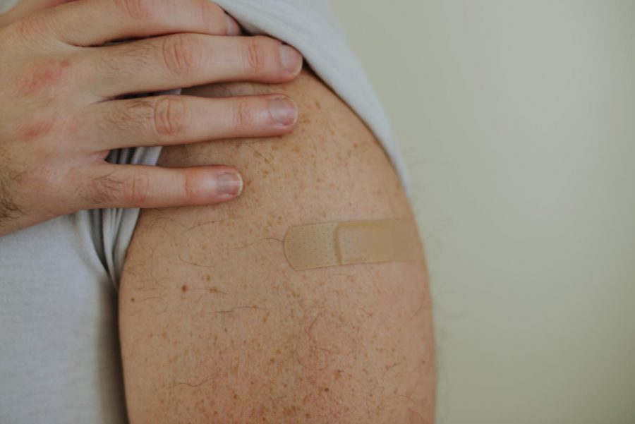 A+photo+illustration+of+what+many+OSU+community+members+can+expect+when+the+COVID-19+vaccine+becomes+available%3A+a+band+aid.