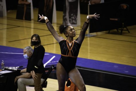 Freshman Ariana Young Greene begins her routine on the balance beam. OSU Women's gymnastics takes the victory against Washington on January 23rd with a score of 194.925 to 192.875