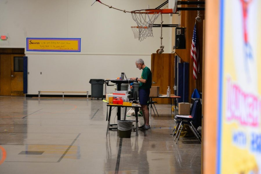 Adams Elementary P.E. teacher Gerhard Behrens monitors class over zoom in the empty gymnasium. Corvallis School District plans to continue to deliver education virtually for the spring term.