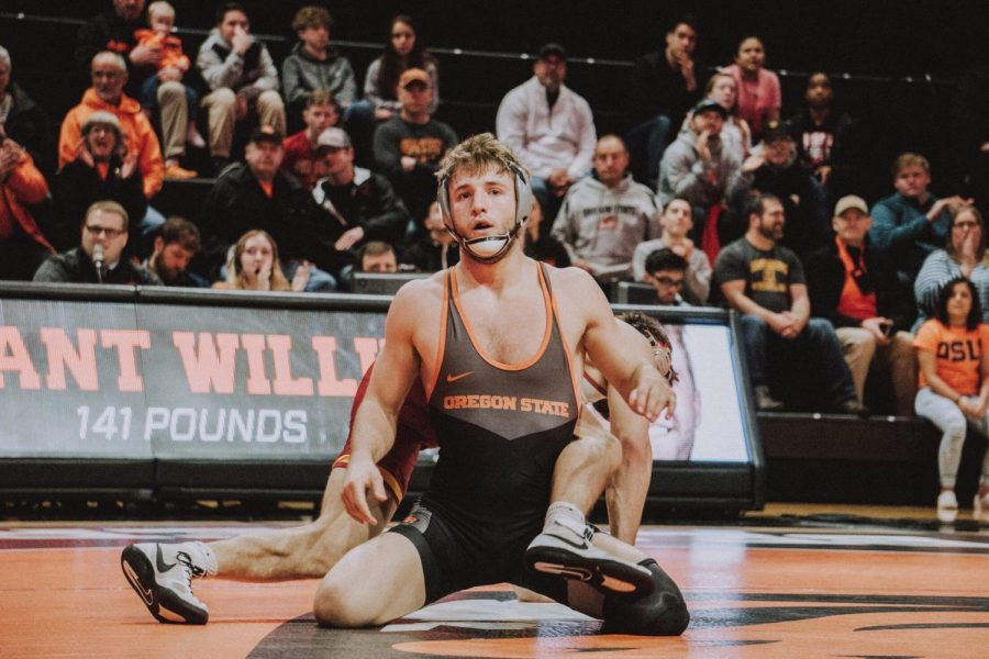 In this file photo from 2019, OSU redshirt freshman 133-pounder Grant Willis finishes a match against Iowa State at Gill Coliseum. Willis is now a sophomore, and is coming off of two wins on Jan. 10, 2021.