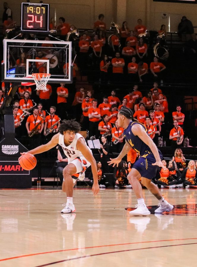 OSU junior Ethan Thompson dribbles up the court past California senior Paris Austin during the game versus California in Gill Coliseum on March 7.