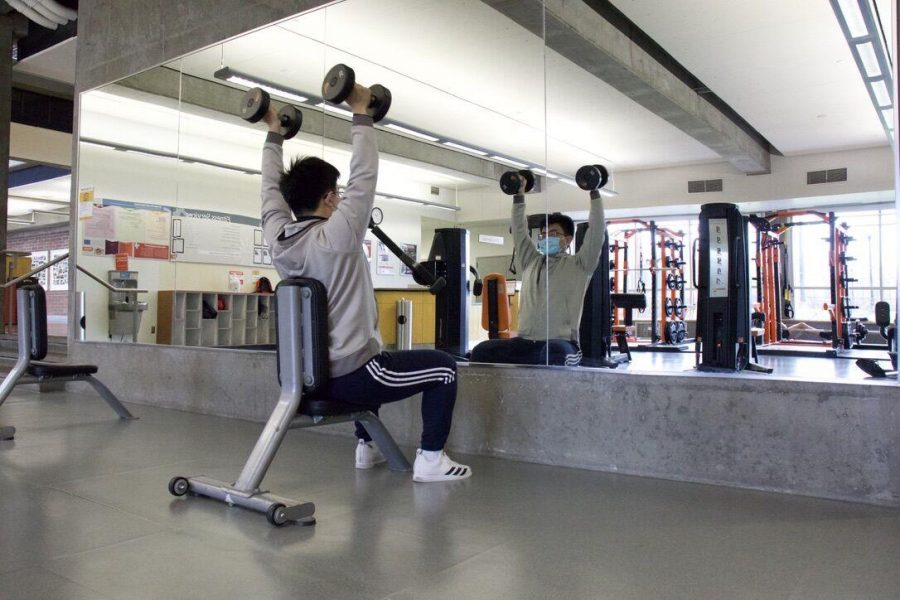 """Jiepeng Zhu, Master of Science in Business, is working out in Dixon Recreational Sport Center on Mon. 8th. """" I think Dixon did a great job on social distancing and making indoor exercise safer,"""" Zhu said."""