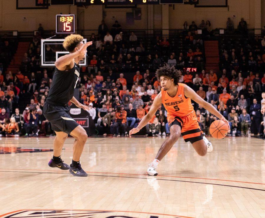 In this photo from 2020, OSU guard Ethan Thompson dribbles back from Colorado junior DShawn Schwartz during matchup in Gill Coliseum on Feb. 15. In their 2021 rematch, Thompson finished with a team-high 18 points in a 71-67 loss that snapped the teams home winning streak.