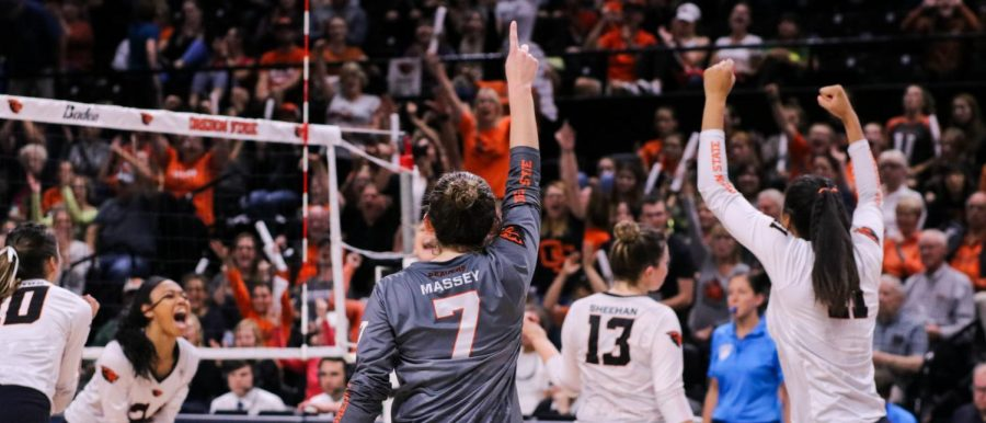 In this file photo from 2019, OSU Volleyball junior libero Grace Massey leads the teams celebration. Massey finished with 27 digs in the Beavers win on Feb. 11, a season high for the senior.