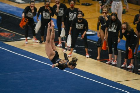 The Oregon State Beavers Gymnastics team cheers on their teammate during a floor routine. OSU Gymnastics faced off against Cal Gymnastics on Sunday, Feb. 21 at Gill Coliseum.