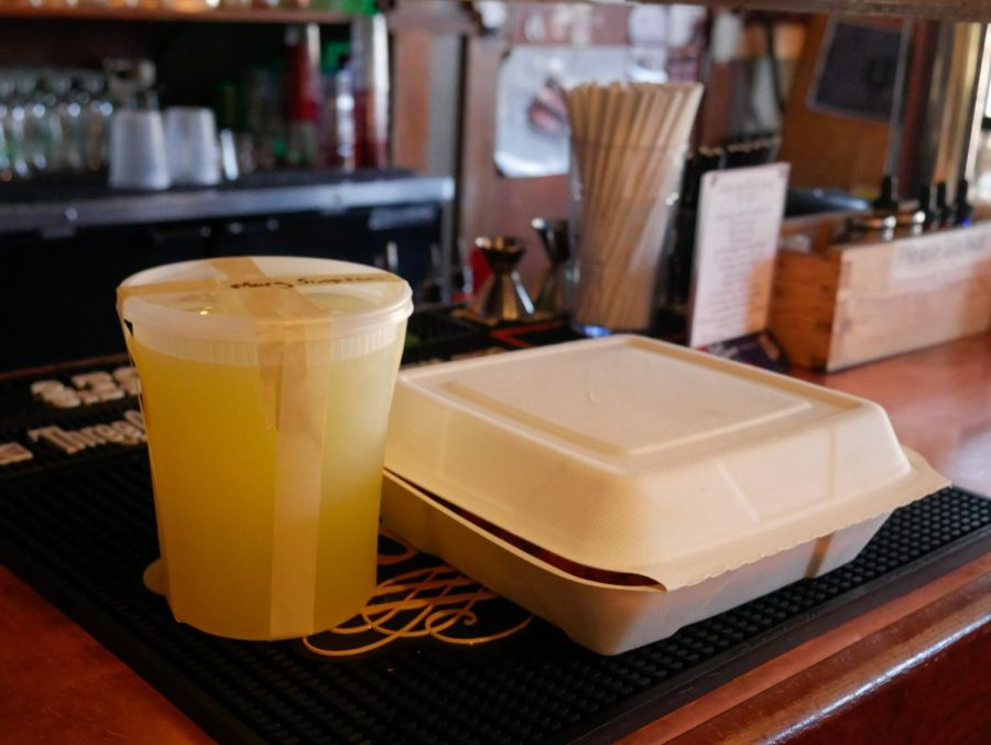 An alcoholic beverage and food served to-go at a local Corvallis bar. As of December 24th, Oregon bars are temporarily allowed to serve cocktails and single servings of wine to go.