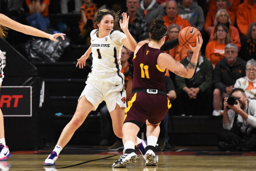 In this file photo from 2020, ASU senior guard Robbi Ryan (#11) maneuvers around OSU junior guard Aleah Goodman (#1) before scoring a two-pointer in the second quarter of the Oregon State vs. Arizona State game at Gill Coliseum, Friday, Feb. 7. On April 15, Goodman was drafted into the WNBA by the Connecticut Sun