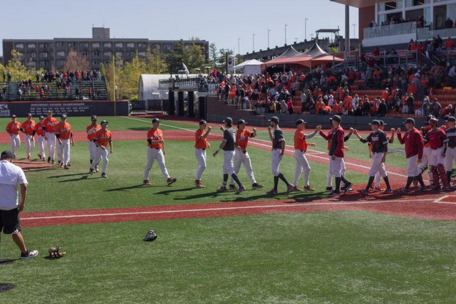 In+this+file+photo+from+2019%2C+OSU+Baseball+exchanges+high+fives+after+a+game+versus+Washington+State+in+late+April+2019+in+Goss+Stadium.+Oregon+State+will+begin+their+2021+season+on+Feb.+19+with+a+56-game+schedule.
