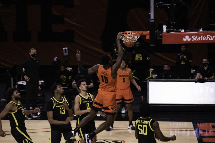 Oregon State junior forward Warith Alatishe sends home a dunk in a March 6 game against the Oregon Ducks. Alatishe would finish with seven rebounds in a PAC-12 Tournament-winning team performance for the Beavers.
