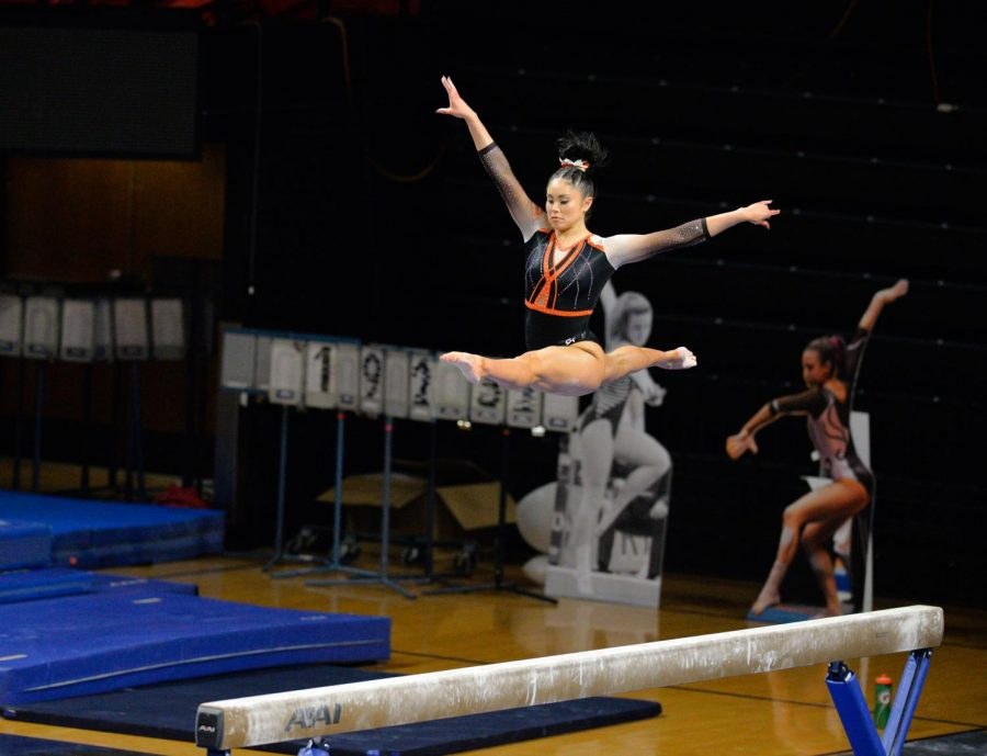 Senior Lexie Gonzalez performs a personal record on the a beam for senior night on Friday against Utah. Oregon State fell behind Utah by a slim margin of 1.150pts.