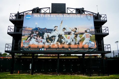 In this file photo from 2017, a banner hangs outside of Goss Stadium celebrating the College World Series wins of the 2006 and 2007 Oregon State Beavers. Oregon State's 2006 championship win was their first in school history.