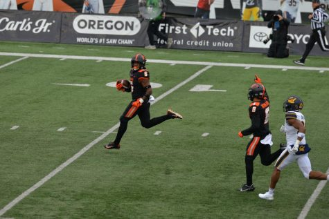 In this photo from Nov. 21, 2020, Oregon State University running back Jermar Jefferson looking back while breaking open a 75 yard touchdown for the opening play. With Jefferson declaring for the NFL draft early, new running backs coach AJ Steward will look to replace the NFL hopeful in the Beavers offense.