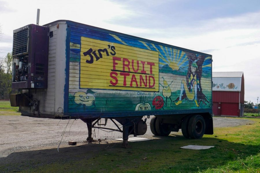 A truck with the labeling of Jim's Fruit Stand in front of an open lot. As of March 29th, everyone in Phase 1B Group 6 of Oregon's vaccination plan is eligible to receive the COVID-19 vaccination. The list of people eligible for the vaccine has now grown to include migrant and seasonal farm workers.
