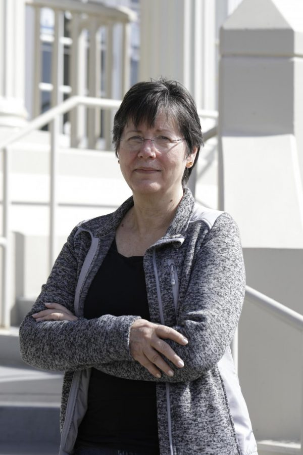 Member of the Corvallis Planning Commission and former City Councilor, Penny York, stands on the front steps of City Hall. Having been an active member of the Corvallis community for many years, she also served as director of Linn-Benton Community College from 1998 to 2007, during which time the college underwent significant expansion.