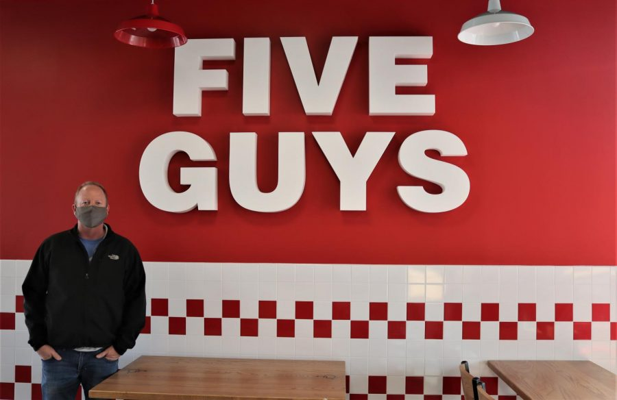 Five Guys Corvallis Owner, Ryan Coady, can be seen in front of the sign of his new establishment. With Five Guys being a growing restaurant chain, Five Guys will bring the wonderful flavors of fresh burgers and fries to the Willamette Valley.