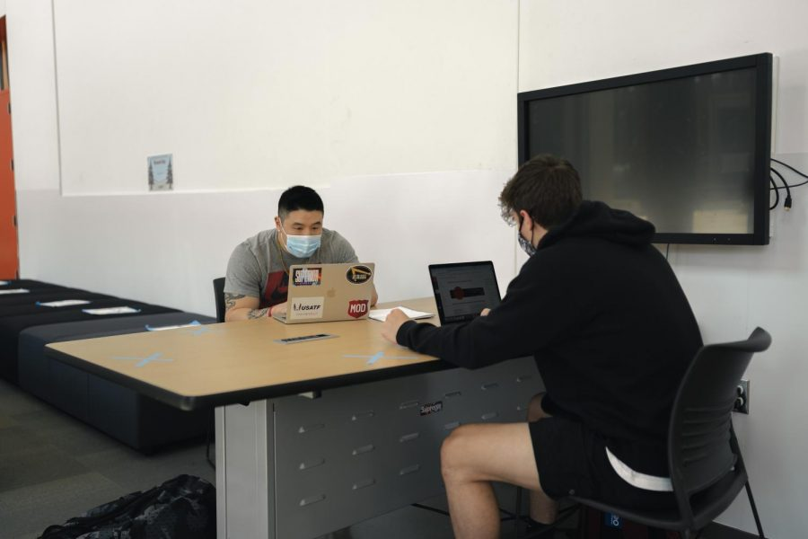 OSU Sophomores Jason Chan, Kinesiology major (left), and Andrew Talley, Accounting and Finance major (right), studying in the Learning Innovation Center. Masks are required inside OSU facilities with limited and socially distanced seating.