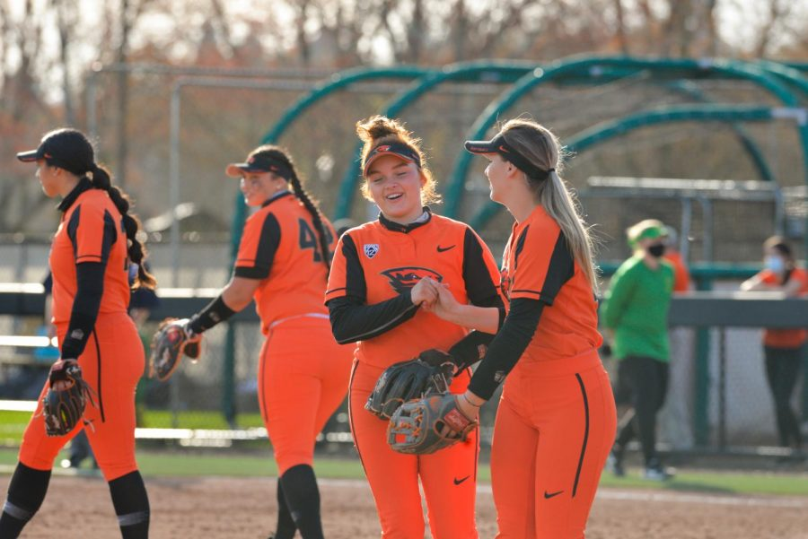 Sophomore shortstop Maya Raider shakes hands with freshman 3rd baseman Grace Messmer before the Ducks were up to bat at the top of the 3rd inning. The Beavers put up a fight against the Ducks but were just edged out by the University of Oregon with a final score of 4-3