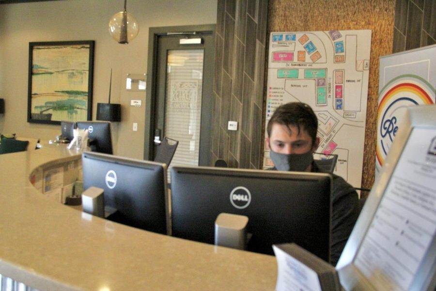A staff member at The Retreat at Corvallis working in the main office of the housing complex. The Retreat is one of several student-apartment complexes close to the OSU campus.