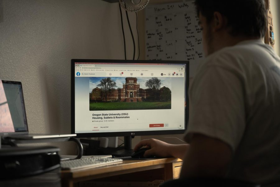 Gus Woolfrey, second-year Oregon State University business management student, looking on Facebook for housing options. For many students, social media has become the biggest aid for students looking for roommates and housing.