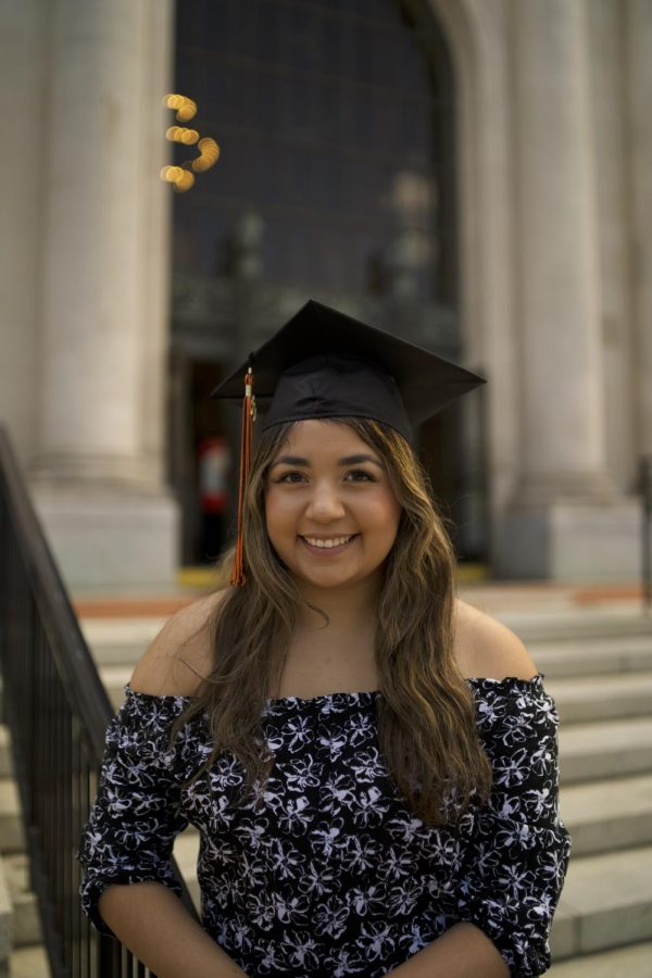 Julia Zavala poses in front of the Memorial Union on the Oregon State University Corvallis, Ore.campus in her graduation cap. Zavala is one of OSU's first generation college graduates, and has earned an Honors undergraduate degree with a biology major and pre-medicine option.
