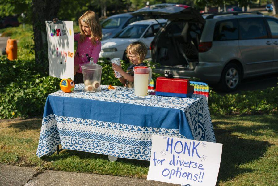 A lemonade/bake saleoutside the Samaritan Health Plans building in Corvallis, Ore. organized by Autumn Benton to help pay for her home birth out-of-pocket. Benton is joined by family, friends, and supporters in protest of Samaritan opting to not cover home births under their insurance plans.