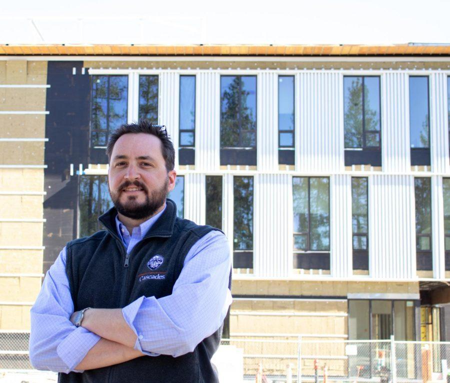 Construction Project Manager, Jarrod Penttila, standing in front of the new Ed Ray Hall building currently under construction at OSU-Cascades. This building is planned to be finished and ready byfall term 2021.
