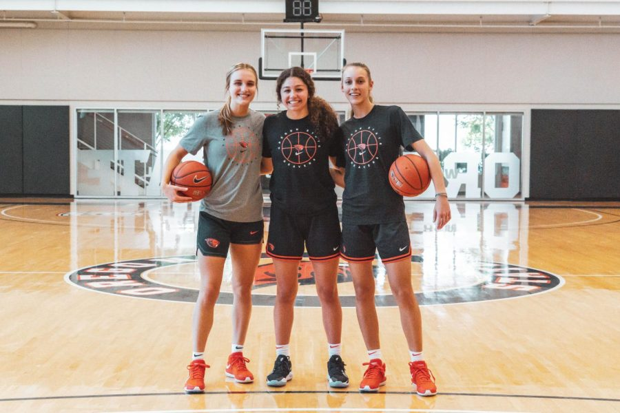A.J Marotte, Talia von Oelhoffen and Greta Kampschroeder (left to right) pose during an OSU Womens Basketball practice. These three teammates are also roommates looking forward to returning to in person classes and games.