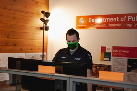 OSU Public Safety Officer, Nic Morrell working during the summer amongst the new mask requirements at the Cascades campus in Bend, Ore. OSU-Cascades follows the main campus in requiring face coverings in all public indoor settings for students and faculty alike.